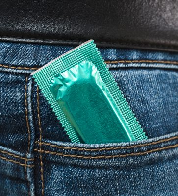 man-holding-condom-in-his-pocket